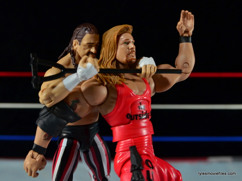 WWE Elite 41 Terry Funk figure review - using the branding iron on Kevin Nash