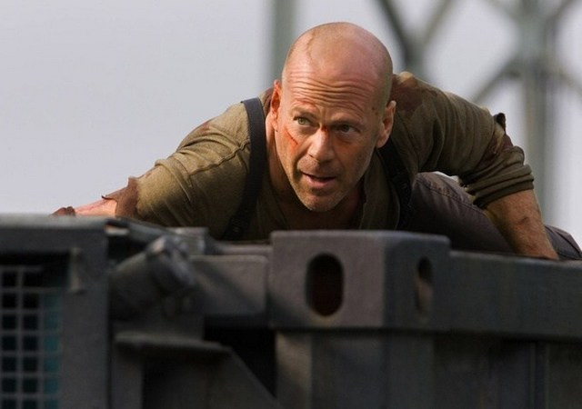bruce-willis-as-john-mcclaine-on-tank-in-live-free-or-die-hard