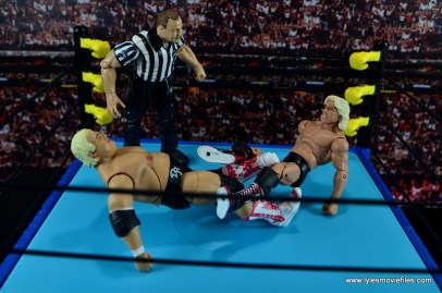 wwe-hall-of-fame-dusty-rhodes-figure-review-trying-to-escape-ric-flair-figure-four-leglock