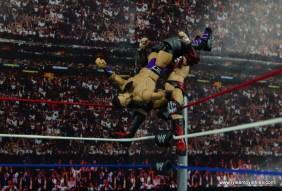 WWE Elite 42 Neville figure review - huricarana to Finn Balor on top rope