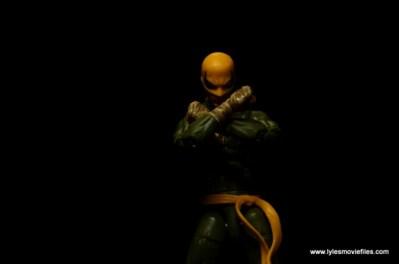 Marvel Legends Iron Fist figure review - dark backdrop