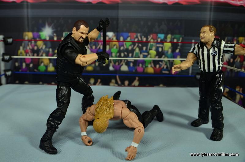 WWE Elite Big Boss Man figure review - using nightstick on Triple H