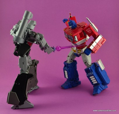 Transformers Masterpiece Megatron figure review -laser sword to Optimus Prime