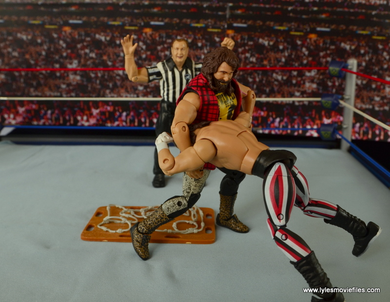 WWE Elite 48 Cactus Jack figure review -setting Terry Funk up for DDT on barbed wire board