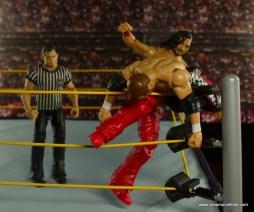 WWE Defining Moments Shinsuke Nakamura figure review -knee in the corner to Sami Zayn
