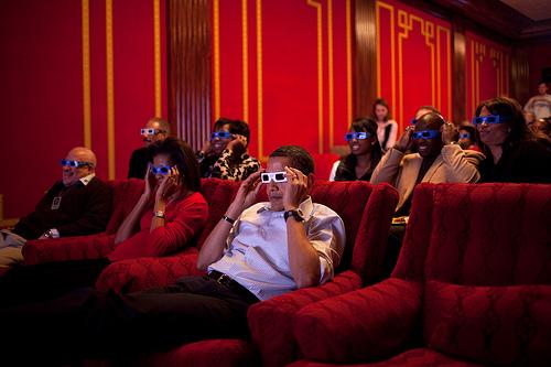 barack obama and michelle obama watching movie