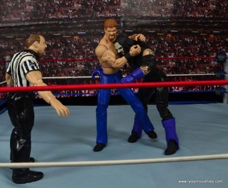 WWE Elite Isaac Yankem figure review -headlock to The Undertaker
