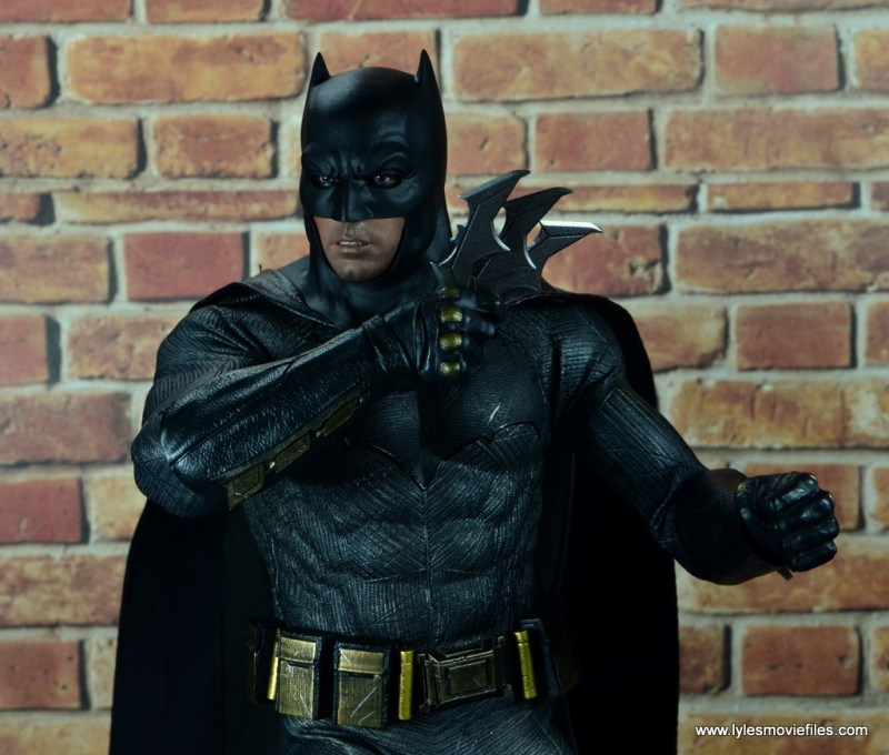 Hot Toys Batman v Superman Batman figure review -holding three Batrarangs