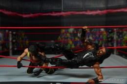 WWE Elite 45 Roman Reigns figure review - apron kick to Seth Rollins