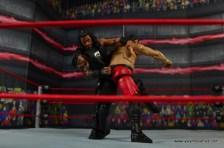 WWE Elite 45 Roman Reigns figure review - knees to Samoa Joe