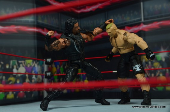 WWE Elite 45 Roman Reigns figure review - punching Brock Lesnar