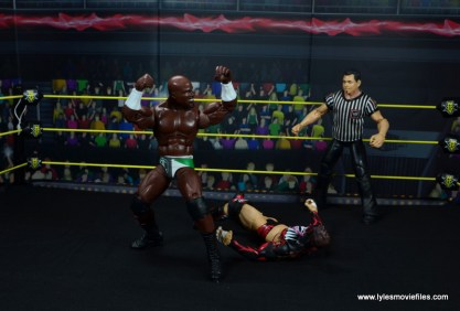 wwe elite 49 apollo crews figure review - preparing to backflip on finn balor