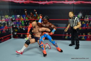 wwe elite xavier woods figure review -abominal stretch elbowsmash