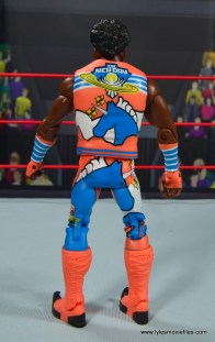 wwe elite xavier woods figure review -rear with vest on