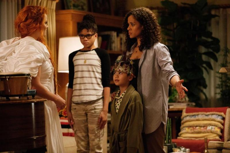 a wrinkle in time review -mrs. whatsit, meg, charles wallace and mrs. murry