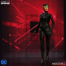mezco catwoman figure walking through laser grid