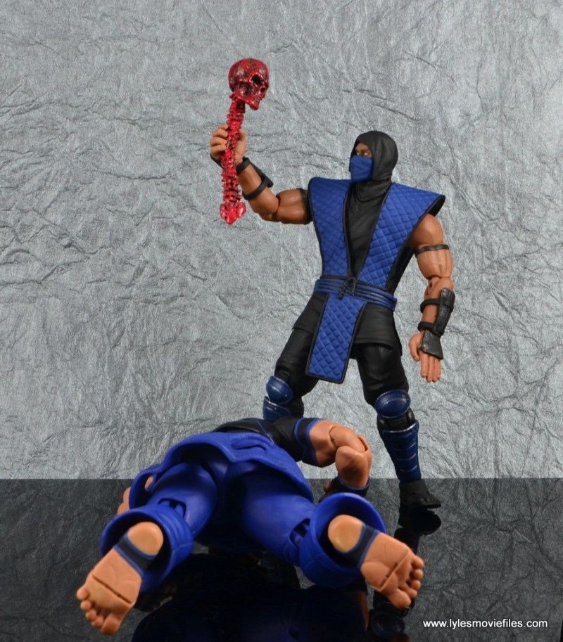 storm collectibles mortal kombat sub-zero figure review - holding skull and spine