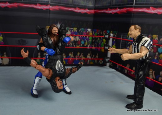 wwe elite 56 aj styles figure review - trying to hit styles clash on roman reigns