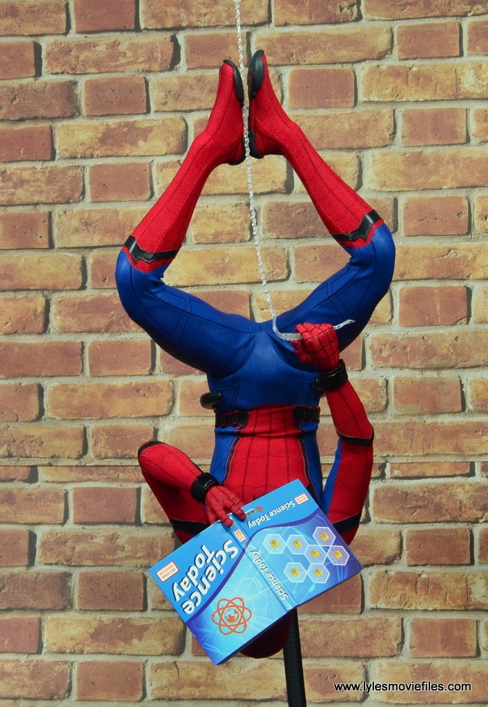 hot toys spider-man homecoming figure review - reading science book upside down