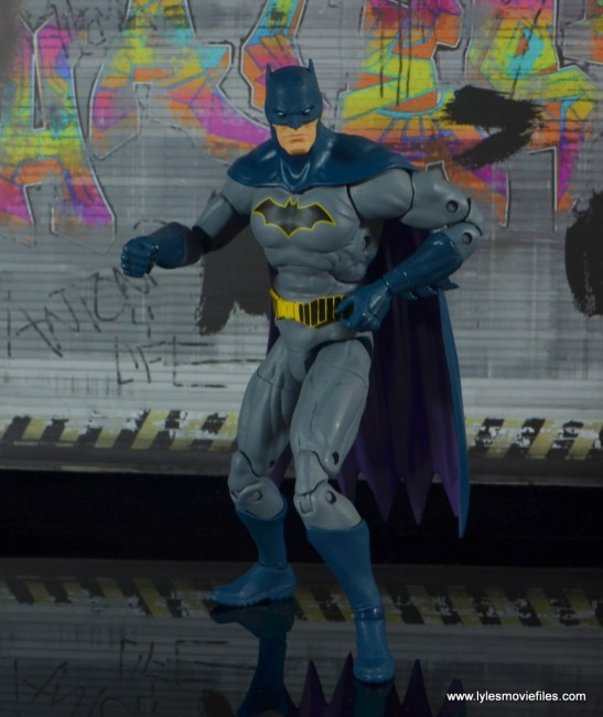 dc essentials batman figure review -reaching into utility belt