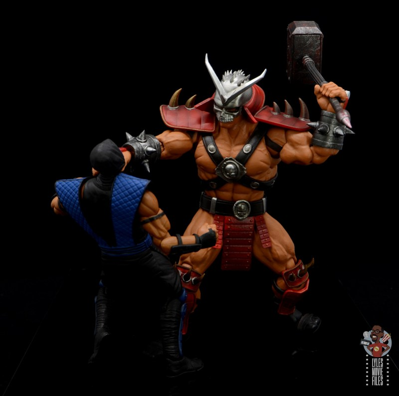 storm collectibles mortal kombat shao khan figure review - throttling sub-zero