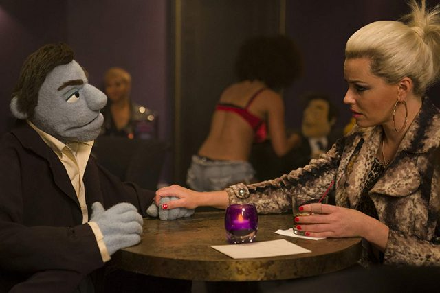 the happytime murders - phil phillips and jenny