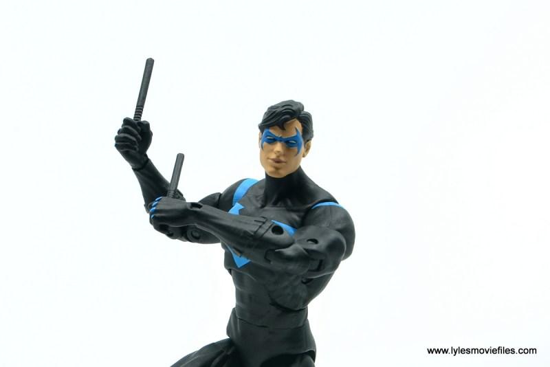 dc essentials nightwing figure review - eskrima sticks