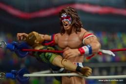 WWE Flashback Ultimate Warrior figure review -corner clothesline to sgt. slaughter