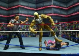 WWE Goldust figure review - stomping on bret hart