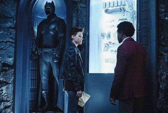 batwoman - looking at the bat suit