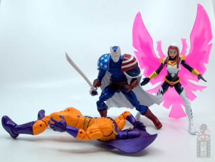 marvel legends citizen v figure review - standing over beaten tiger shark with songbird