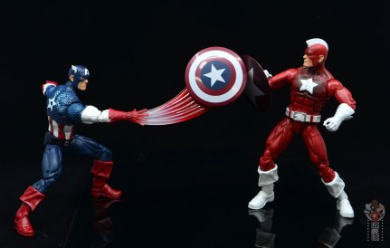 marvel legends captain america figure review 80th anniversary - throwing shield at red guardian