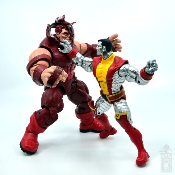 marvel legends colossus and juggernaut figure review 80th anniversary - colossus peeling juggernaut's helmet