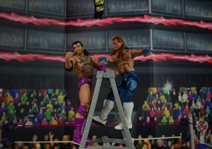wwe network spotlight shawn michaels figure review - punching razor ramon atop ladder