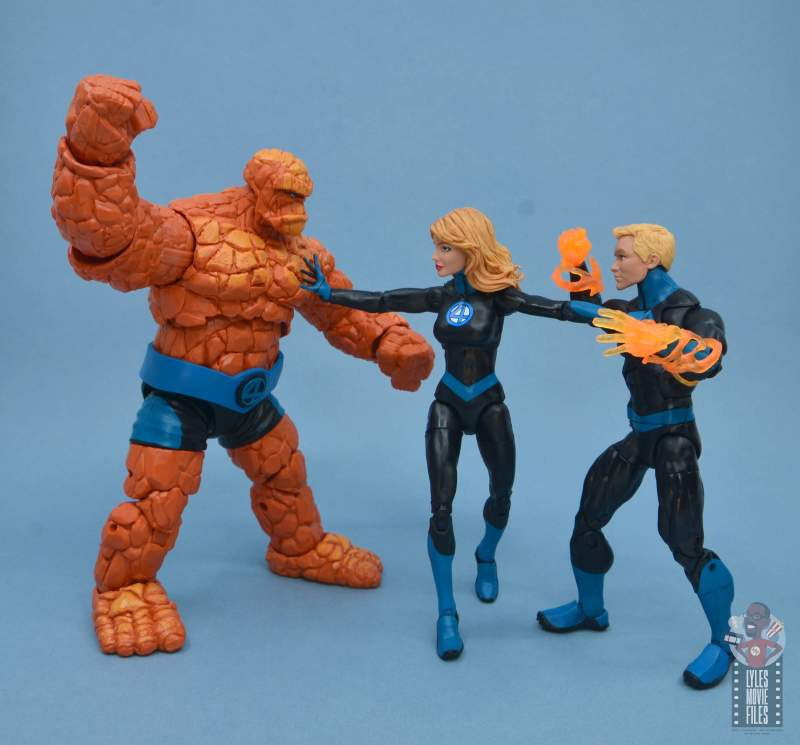 marvel legends invisible woman figure review - holding back johnny and ben