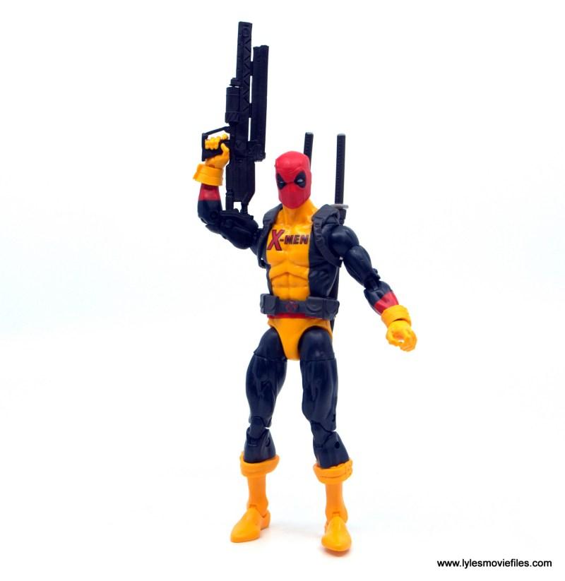 marvel legends deadpool figure review -holding the blaster up
