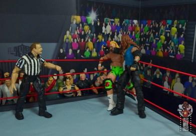 wwe elite 68 american badass undertaker figure review - corner elbow to billy gunn