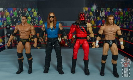 wwe elite 68 american badass undertaker figure review - scale with the rock, kane and triple h