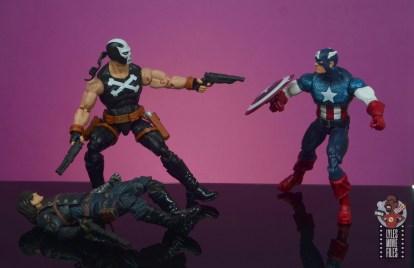 marvel legends crossbones figure review - holding off captain america