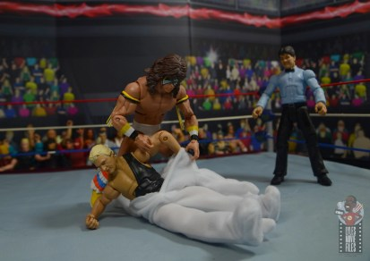 wwe legends 7 bobby the brain heenan figure review - ultimate warrior putting on the weasel suit