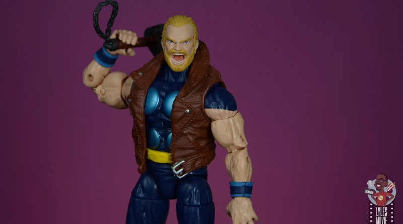 marvel legends thunderstrike figure review - bringing mace over shoulder