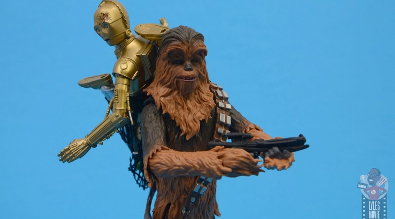 star wars the black series chewbacca and c-3p0 figure set review - wide shot with stormtrooper blaster