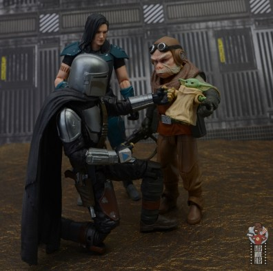 star wars the black series kuill figure review -holding the child