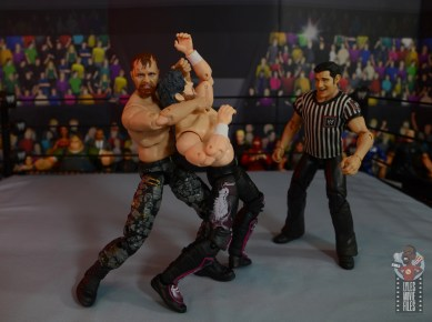 aew unrivaled jon moxley figure review - rear arm choke to kenny omega