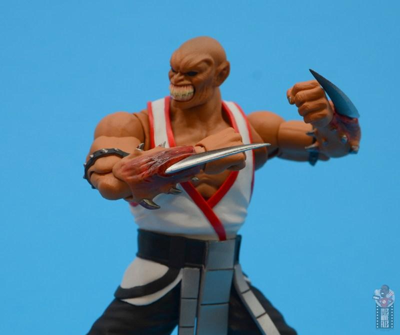 storm collectibles mortal kombat baraka figure review - blade side close up