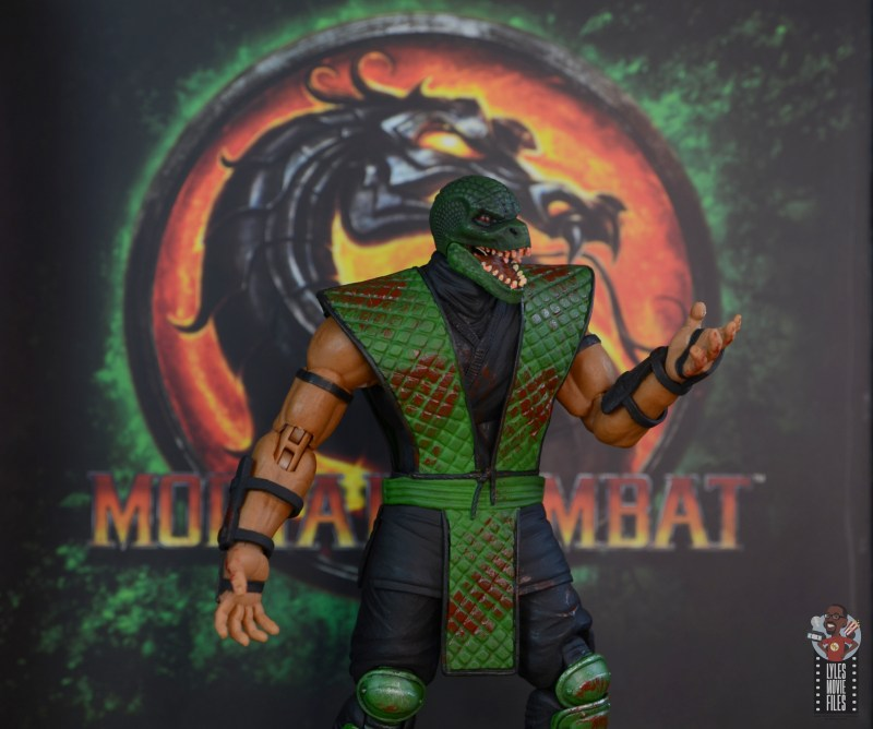 storm collectibles mortal kombat reptile figure review - with mk background