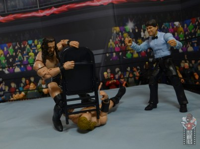 aew-unrivaled-pac-figure-review-choking-out-hangman-with-steel-chair
