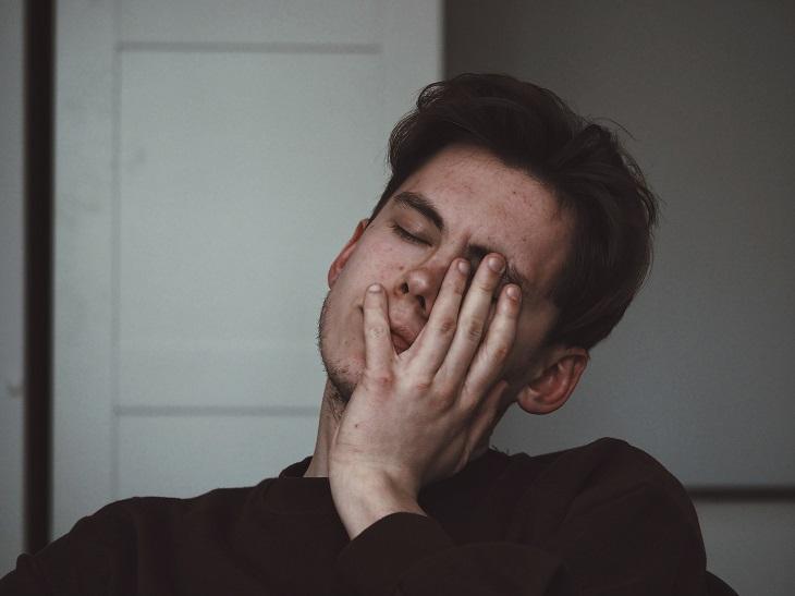 man experiencing fatigue