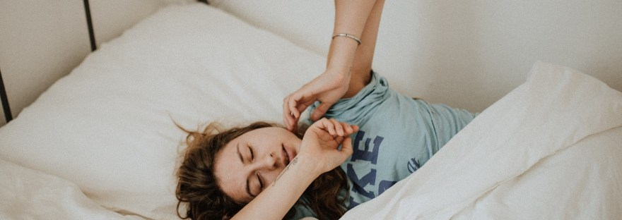 woman with chronic fatigue in bed