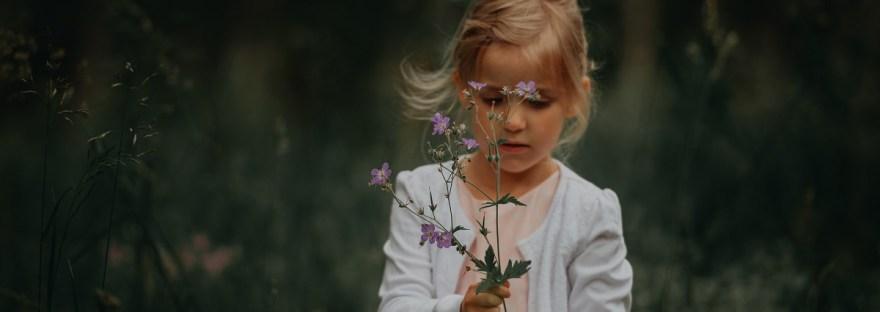 child in grassy field
